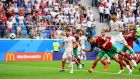 Bouhaddouz heads for infamy to give Iran stunning late win