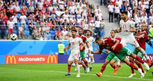 Morocco's forward Aziz Bouhaddouz  heads home an own goal in the World Cup Group B  match against  Iran at the St Petersburg Stadium. Photograph: Giuseppe Cacace/AFP/Getty Images