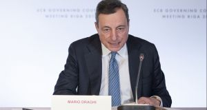 "Mario Draghi, president of the European Central Bank: rates will remain where they are ""through the summer"" of next year.  Photograph: Jasper Juinen/Bloomberg"
