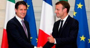 Italian prime minister Giuseppe Conte and French president Emmanuel Macron shake hands after a joint press conference   in Paris. Photograph: Francois Mori/AFP/Getty Images