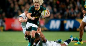 South Africa fly-half Faf de Klerk is tackled during the first Test against England at Ellis Park  in Johannesburg. Photograph: Gianluigi Guercia/AFP/Getty