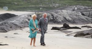 Prince Charles and Camilla walk on Derrynane beach in Co Kerry. Photograph: Niall Carson, Getty Images