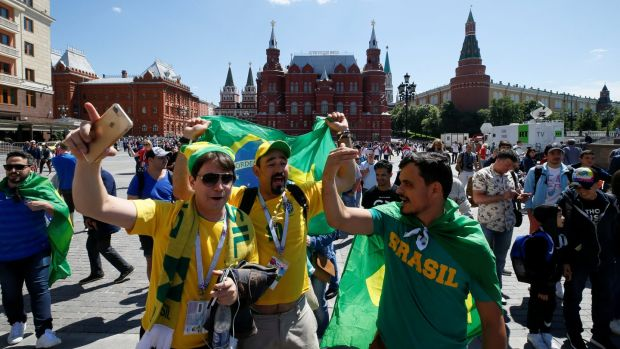 Brazil supporters gather near the Kremlin in central Moscow. Photograph: Gleb Garanich/Reuters