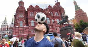 Soccer fans gather near Red Square in Moscow. Photograph: Facundo Arrizabalaga/EPA
