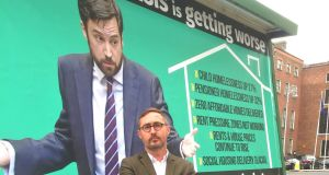 When the huge poster was unveiled on Tuesday, Sinn Féin's housing spokesman Eoin Ó Broin posed happily beside it.  Photograph: Cate McCurry/PA Wire