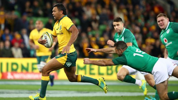 Kurtley Beale scores Australia's early opening try in Melbourne. Photograph: Scott Barbour/Getty