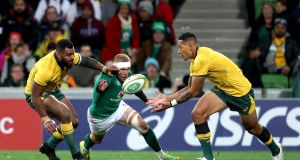 Ireland's Keith Earls challenges for the ball with Australia's Israel Folau and Marika Koroibete during the second Test at AAMI Park in Melbourne. Photograph: Dan Sheridan/Inpho
