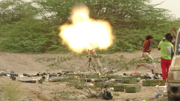 Yemeni pro-government forces fire a mortar round in the in the battle for Hodeida. Photograph: