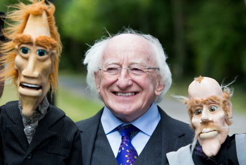 "President  Higgins  with puppets ""Eamon"" and ""Pascal "" from the ""Your Man's Puppets "" in Galway  during a Bloomsday Garden Party, at Aras an Uachtarain. Photo: Tom Honan."