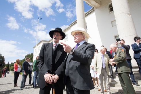 President  Higgins and John Shevlin, as the character Joyce  at a Bloomsday Garden Party in Aras an Uachtarain. Photo: Tom Honan.