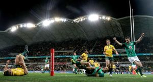 Andrew Conway scores Ireland's first try during the second Testa at AAMI Park, Melbourne. Photograph: Dan Sheridan/Inpho