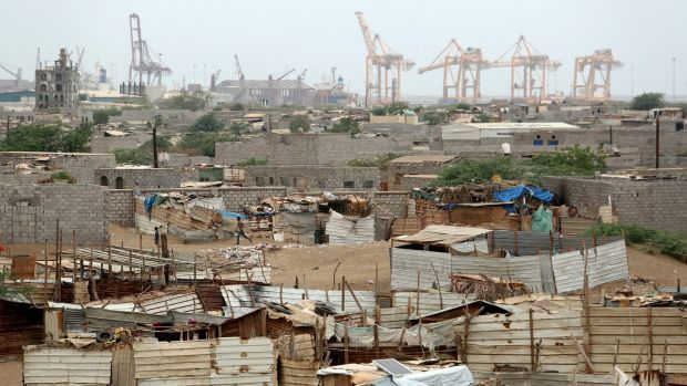 Port cranes in Hodeidah, Yemen, from a nearby shantytown. The UN says 70% of humanitarian supplies and 90% of commercial supplies enter Yemen through the port. Photograph: Reuters