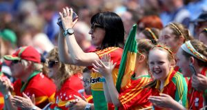 Carlow fans in Croke Park for the Leinster semi-final against Laois. Turlough O'Brien believes  improving the fortunes of the football team will inject some much needed pride and self-confidence into the county. Photograph: Bryan Keane/Inpho
