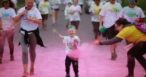 More than 5,000 people participated in the Irish Cancer Society's Colour Dash sponsored by Aldi in the Phoenix Park. Photograph: Nick Bradshaw