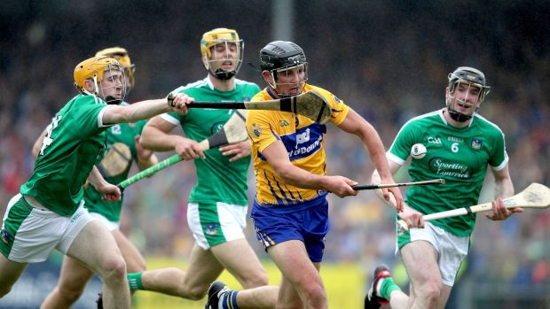 Clare's Cathal Malone and Richie English of Limerick in action in Ennis. Photograph: Bryan Keane/Inpho