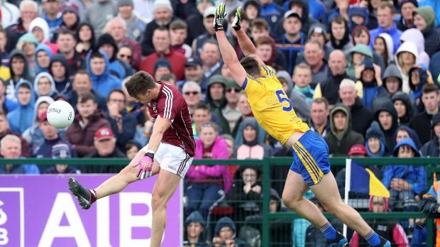 Roscommon's John McManus can't stop Shane Walsh scoring his second point. Photograph: Tommy Dickson/Inpho
