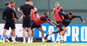 Raheem Sterling and Trent Alexander-Arnold enjoy a drill during an England training session  in St Petersburg. Photograph: Oleg Nikishin/Getty Images