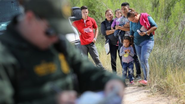 Central American asylum seekers wait as US.Border Patrol agents take groups of them into custody on June 12th. Photograph: John Moore/Getty Images