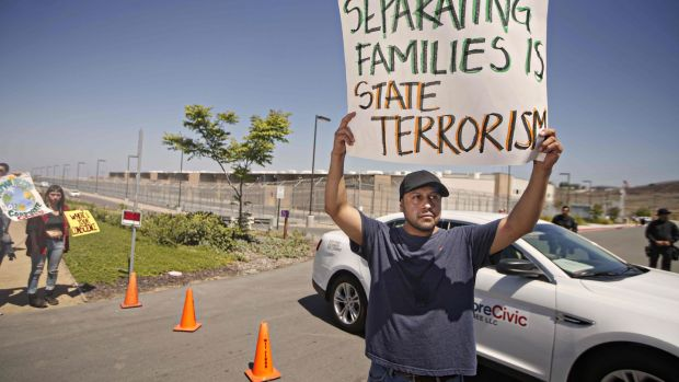 A protester display a sign while participating in a demonstration against immigration enforcement officials separating undocumented families at the Otay Mesa Detention facility in Otay Mesa, California on June 10th. Photograph: Sandy Huffaker/AFP