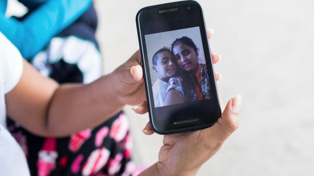 Elsa Johana Ortiz Enriquez shows a picture of her and her son Anthony on her mobile phone. Photograph: Marian Carrasquero/The New York Times