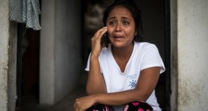 Elsa Johana Ortiz Enriquez, who was deported to Guatemala from the United States on June 5th without her son Anthony, 8, speaks to a social worker in San Mauricio, Guatemala. Photograph: Marian Carrasquero/The New York Times