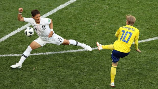 Sweden's Emil Forsberg tries to shoot past South Korea's Jung Woo-young. Photograph: Lucy Nicholson/Reuters