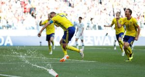 Sweden's Andreas Granqvist celebrates scoring their  penalty. Photograph: Matthew Childs/Reuters