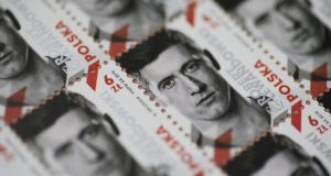 A postage stamp with the image of Poland captain Robert Lewandowski. Photograph: Leszek Szymanski/EPA