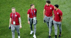 England's Jordan Pickford, Kieran Trippier, Harry Maguire and Kyle Walker walk on the Volgograd Arena pitch ahead of the World Cup Group G match against Tunisia in Volgograd. Photograph: Gleb Garanich/Reuters