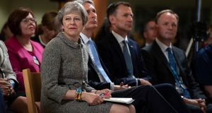 The British prime minister, Theresa May, with the chancellor of the exchequer, Philip Hammond, and the health secretary, Jeremy Hunt, ahead of delivering a speech at the Royal Free Hospital in London on Monday. Photograph: Will Oliver/EPA