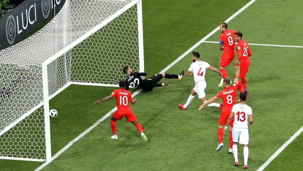 Harry Kane scores England's opener against Tunisia. Photograph: Ryan Pierse/Getty