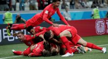 England's Harry Kane celebrates with team-mates after scoring their first goal in the World Cup Group G  game against Tunisia at the   Volgograd Arena. Photograph: Ueslei Marcelino/Reuters