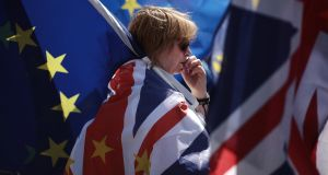 An anti-Brexit demonstrator looks pensive during a protest outside the Houses of Parliament on June 11th in London. Photograph: Dan Kitwood/Getty Images