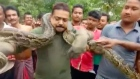 Not so charming: posing with python nearly turns fatal