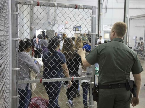 This US Customs and Border Protection photo obtained June 18, 2018 shows intake of illegal border crossers by US Border Patrol agents at the Central Processing Center in McAllen, Texas on May 23, 2018. / AFP PHOTO / US Customs and Border Protection / Handout /AFP/Getty Images