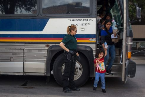 "Immigrants are dropped off at a bus station shortly after being released from detention through ""catch and release"" immigration policy on June 17, 2018 in McAllen, Texas.  The man said he was separated from his son while in detention. ""Catch and release"" is a protocol under which people detained by US authorities as unlawful immigrants can be released while they wait for a hearing.  / AFP PHOTO / Loren ELLIOTTLOREN ELLIOTT/AFP/Getty Images"