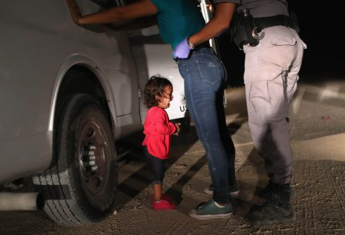 "A two-year-old Honduran asylum seeker cries as her mother is searched and detained near the U.S.-Mexico border on June 12, 2018 in McAllen, Texas. The asylum seekers had rafted across the Rio Grande from Mexico and were detained by U.S. Border Patrol agents before being sent to a processing center for possible separation. Customs and Border Protection (CBP) is executing the Trump administration's ""zero tolerance"" policy towards undocumented immigrants. U.S. Attorney General Jeff Sessions also said that domestic and gang violence in immigrants' country of origin would no longer qualify them for political asylum status.  (Photo by John Moore/Getty Images)"