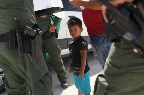 U.S. Border Patrol agents take into custody a father and son from Honduras near the U.S.-Mexico border on June 12, 2018 near Mission, Texas. The asylum seekers were then sent to a U.S. Customs and Border Protection (CBP) processing center for possible separation. U.S. border authorities are executing the Trump administration's zero tolerance policy towards undocumented immigrants. U.S. Attorney General Jeff Sessions also said that domestic and gang violence in immigrants' country of origin would no longer qualify them for political-asylum status.  (Photo by John Moore/Getty Images)