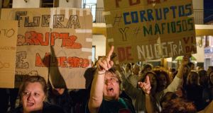 People shout slogans against corruption during a protest outside Madrid in 2014. Photograph: Sergio Perez/Reuters