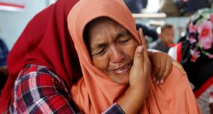 Lela Supiyanti, cries for her daughter, a passenger on the KM Sinar Bangun ferry which sank yesterday in Lake Toba, Indonesia on Monday. Photograph: Beawiharta/Reuters