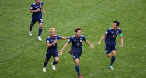 Yuya Osako  celebrates scoring Japan's second  goal with his team-mates   during  the  Group H match  at Mordovia Arena  in Saransk. Photograph: Clive Brunskill/Getty Images