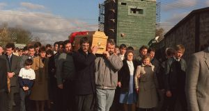 A file image showing the coffin of Aidan McAnespie being carried through the British army checkpoint  where he was shot dead.  Photograph: Pacemaker
