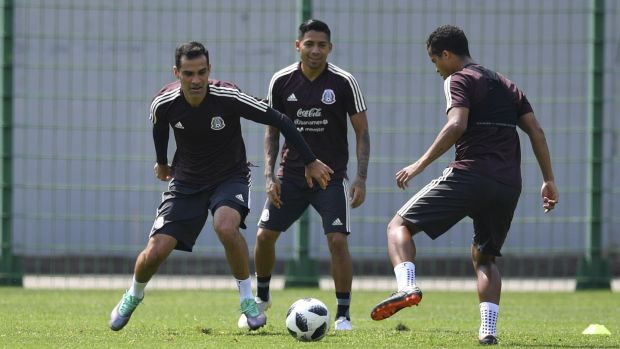 Mexico's defender Rafael Marquez (left) trains alongside midfielder Javier Aquino and forward Giovani Dos Santos at at the Novogorsk training centre outside Moscow. Photograph: Yuri Cortez/AFP/Getty Images
