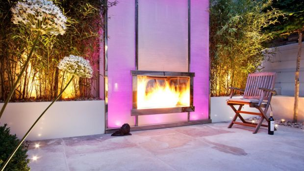 Kate Gould's snazzy design uses glass, polished stainless steel and mirror to bring not just heat but illumination and colour to your garden. Photograph: The Garden Builders