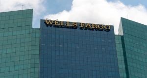 Wells Fargo may trim about 1,000 jobs through attrition and cut 100 regional managers.