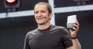Mario Queiroz, vice president of product management for Google, holds a Google Home device.