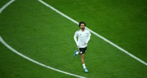 Egypt's Mohamed Salah warms up before the Group A match against Russia in St Petersburg. Photograph: Michael Dalder/Reuters