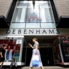 Shoppers walk past a Debenhams shop in Oxford Street,  London.  The group's poor performance has been blamed on increased discounting by rival high street retailers. Photograph: Tolga Akmen/AFP/Getty