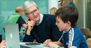 On his visit to the Apple facility in Hollyhill, Cork, the company's chief executive, Tim Cook, met 14-year-old developer Niall Kehoe.