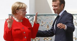 "German chancellor Angela Merkel and French president Emmanuel Macron: Mr Macron envisions a €300 billion fund but Dr Merkel one of only ""low double-digits"". Photograph: Michele Tantussi/Getty"
